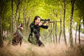 Autumn hunting season. Hunting. Outdoor sports. Woman hunter in the woods poster