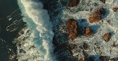 Aerial Photography. View From Above.  Seascape. A Huge Wave Is Breaking Against The Rocks.foam Waves poster