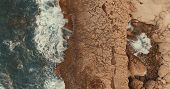 Aerial Photography.stone Cliff. Waves Beat Against The Rocks. Foam Waves. One Wave Rolls On The Othe poster