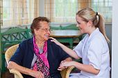 stock photo of geriatric  - a nurse home care visits a patient - JPG