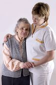 stock photo of elderly woman  - Health care worker and elderly woman needs help - JPG