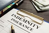 Indemnity Insurance Policy On The Dark Table. poster