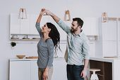 Young Happy Couple Dancing In Modern Kitchen. Breakfast At Morning. Happy Wife And Husband. Romantic poster