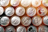 Many aluminium cans, closeup. Recycling concept poster