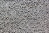 Beautiful Decorative Gray Plastered Wall With Rough Texture. Gray Plastered Handmade Rough Wallpaper poster