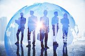 Businesspeople On Abstract City Background With Globe And Daylight. Global Business And Globalizatio poster