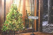 Christmas Tree With Welcome Inscription Outside. Evening Street House Entrance And Christmas Tree Wi poster
