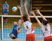 KAPOSVAR, HUNGARY - OCTOBER 21: Zsanett Pinter (L) in action at a Hungarian NB I. League volleyball