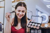 Getting Ready. Beaming Good-looking Woman Holding Eye Brush While Getting Ready For Romantic Date poster