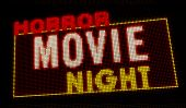 Horror Movie Night Retro Intro Illuminated Letters On Big Neon Display With Large Pixels. Bright Lig poster