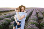 Young Woman In Blue Dress Hat Walk On Purple Lavender Flower Meadow Field Background, Rest, Have Fun poster