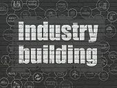 Industry Concept: Painted White Text Industry Building On Black Brick Wall Background With Scheme Of poster