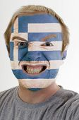 Face Of Crazy Angry Man Painted In Colors Of Greece Flag
