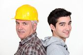 picture of school-leaver  - Tradesman standing back to back with his apprentice - JPG