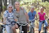 stock photo of senior-citizen  - Elderly people riding their bikes - JPG