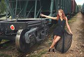 stock photo of boxcar  - beautiful woman in the railroad - JPG