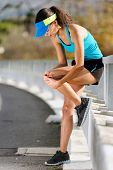 knee injury for athlete runner. woman in pain after hurting her leg while training for fitness marat