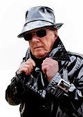 Menacing man in black coat and hat