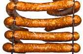 Four Sausages Ready To Smoke Isolated
