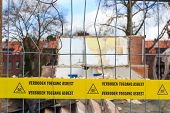 Yellow Tape With Dutch Text 'no Trespassing Asbestos'