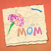 Happy Mothers Day concept with colorful text Mom and flowers on shiny brown paper.