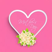 Pink heart with text Mothers Day and flowers for Happy Mothers Day concept.