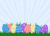 picture of easter-eggs  - variety of colourful decorated easter eggs hidden in grass - JPG