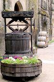 Old Wine Press And Barrels At The Vineyard