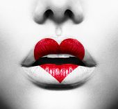 Beauty Sexy Lips with Heart Shape paint. Love Concept. Kiss