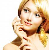 Beauty Blonde Fashion Model Girl With Golden Earrings. Beautiful Hair and Nails. Manicure and Skinca