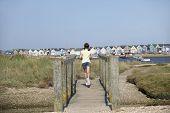 Young Girl On Foot Bridge