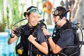 picture of oxygen  - Asian people at the diver Course in diving school in wetsuit with an oxygen tank - JPG