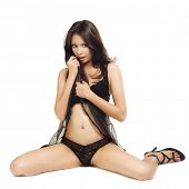 Beautiful young woman wearing black baby doll lingerie