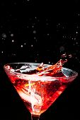 red splashing cocktail on black