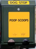 pic of pooper  - poop scoop bag dispenser for dog poo in park - JPG