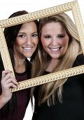 pic of bff  - Beautiful women best friends looking through a picture frame - JPG