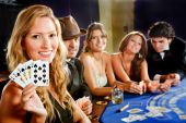 image of poker hand  - Poker players sitting around a table at a casino - JPG
