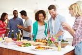 stock photo of food groups  - Group Of Friends Having Dinner Party At Home - JPG