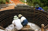 Worker Casting Cement Culvert For Road-works