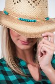 stock photo of redneck  - Womans cowboy hat with turquois beaded band - JPG