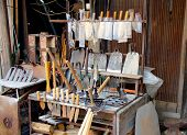 image of blacksmith shop  - Blacksmith shop with knives and farming products - JPG