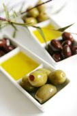 stock photo of kalamata olives  - Green olives kalamata and olive oil in a white container - JPG