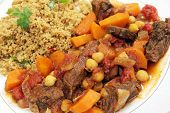 stock photo of tagine  - Plate of traditional Moroccan beef tagine with couscous - JPG