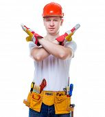 working man in helmet crossed hands on white background isolated