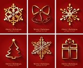 Greeting cards with golden Christmas symbols.