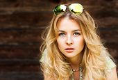 image of natural blonde  - Portrait of Beautiful Blonde Woman on Wooden Wall Background - JPG
