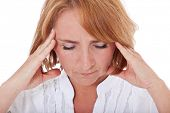 Adult woman suffers from headache. All on white background.