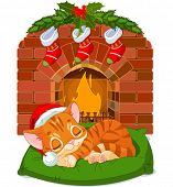 Cute little kitten with Santa�?�¢??s Hat sleeping near Fireplace