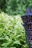 picture of citronella  - Close up of a mosaic garden torch - JPG