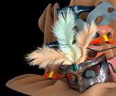 metal carnival mask with feathers and masks on background